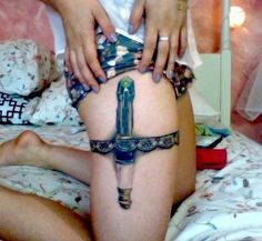Now that's a sexy place to stash your lightsaber. #InkedMagazine #tattoo #Lightsaber #tattoos #StarWars #sith #jedi #darkside #theforce