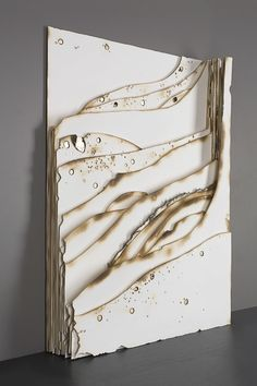 Kelly M. O'Brien, Playing With Fire No. 34 . Paper, gold leaf, flame. 27.5 x 19.5 x 4.2 inches. ©2016. Commissioned for Norwegian Cruise Lines Joy .