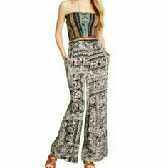 Flirty printed jumpsuit/romper NWT. Flirty printed jumpsuit/romper. You can dress it up or down. Just in time for the summer!!!!!!! Size M   Product Details:  Mixed print Polyester Surplice neckline Pants Jumpsuits & Rompers