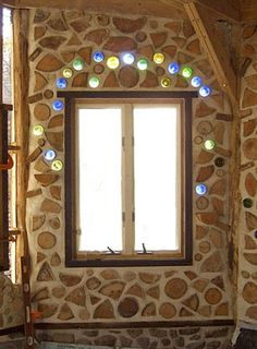"""This is takes """"one mans trash is another mans treasure"""" to a whole new level...this would be beautiful to have a whole wall with light streaming thru these coloured bottles."""
