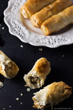 Phyllo Dough Meat Rolls from The Mediterranean Dish. Recipe includes step-by-step photos! These flaky rolls make the perfect party appetizer!  #Phyllo #PartyAppetizer #Mediterranean http://www.themediterraneandish.com/phyllo-dough-recipe-meat/