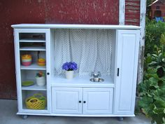 I converted this old entertainment center into a play kitchen for my kids.  But now I have to sell it!