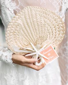 ChalkboardHope created these custom palm-leaf fans so guests could keep cool during the ceremony.