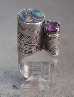 Ring | Derek Wilson (Haisla Nation) 'Bear and Human'. Hand carved sterling silver, amethyst, abalone. ca. 1990