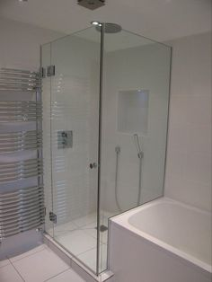 Shower screen like this cut around the bath although with no hob in the shower