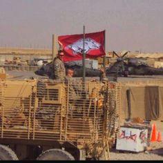 My husband's platoon supporting the Arkansas Razorbacks in Afghanistan.