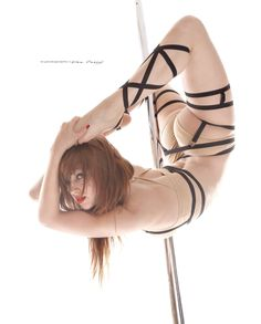 Pole fitness - Photography by Don Curry.   Flexibility at its finest.