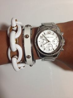 Dark silver Michael Kors watch with white and silver bracelets