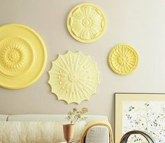 ceiling medallion wall art.... cheap wall art :) These come in white and can be spray painted in any color :)