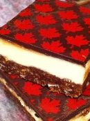 Our Nanaimo Bars branded with the red maple leaf of the Canadian flag using transfer paper. How cool is that?