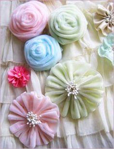 Various Ribbon Flowers... http://www.narrow-fabrics-manufacturers.com/photo-gallery/ribbon-flowers-satin-organza.html