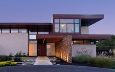 stucco/wood exterior/black windows