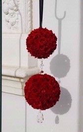 Red Wedding Decorations Idea - These red pomander balls are a great idea for decorating the entrance to your wedding or they could be used as hanging centrepieces over your tables.