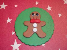 This listing is for a set of (12) adorable gingerbread man edible fondant cupcake toppers. I have them on a green background disc but if you