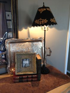 Place a silver serving tray on a stand next to candles etc...