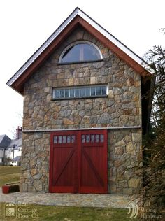 Mahogany Exterior Barn Door By Real Carriage Door Co. With Stainless Steel  Box Rail Sliding
