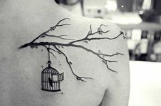 Bird Cage Hanging from Branch Tattoo