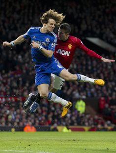 Chelsea's David Luiz, left, jumps for the ball against Van Persie.
