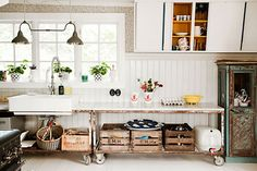 10 Must-See Kitchens To Inspire A Makeover In Yours #refinery29  http://www.refinery29.com/kitchen-ideas#slide11  The natural wood crates here add a break from the white. Also, note the subtle, yellow paint inside the cabinets.