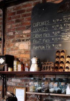 Love the bricks & jars & board (cozy, café, coffeehouse, coffee shop, blackboard, chalkboard, chalk, black, board)
