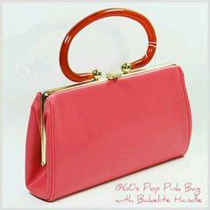 1960's Pop Pink Bag with Bakelite Handle from Dustbunny Vintage. The hot pink is bold enough to make an outstanding arm candy!