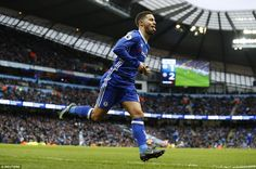 The Belgium international sticks his tongue out in celebration after securing the three points for Antonio Conte's side