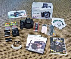 Canon EOS 7D 18.0MP DSLR Digital Camera Body  EXTRAS: Batteries CF Cards DVDs