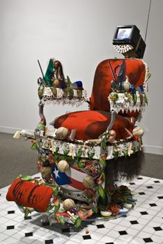 Pepon Osorio, En la Barberia no se Llora (No Crying Allowed in the Barbershop), 1994. Mixed media; 63 1/2 x 60 x 60 in. Purchased through a gift of Southern New England Telephone in recognition of the vitality of Connecticut's Puerto Rican community, and through the Alexander A. Goldfarb Contemporary Art Acquisition Fund, 1994.37.1