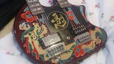 "This guitar was made with inspiration by jimmy page . in Japan by Fernandes Japan . Project Called ""Art Rock"" back in 2000's as far as I know there is only handful was made,  Guitar has been checked in Japan and well as local shop in USA and sounds great. This guitar was the highest priced guitar that was made , out of 4 series that they made . there are 4 series and this one if you can find it , you might want to get it because it does not have any d..."