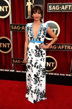 """The Boldest Red Carpet Looks From The SAG Awards #refinery29 http://www.refinery29.com/2015/01/81264/sag-awards-2015-red-carpet-pictures#slide-23 There was something a little too casual about Rashida Jones' Ungaro gown with black-and-white wallpaper flowers and a blue trim — but, that """"Oh, I'm on the red carpet?"""" attitude was one of the reasons we liked it so much. Jones took it easy on the accessories and kept her look simple and straightforward — no fuss, no muss."""
