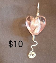 Pink foil heart silver wire wrapped spiral pendant.