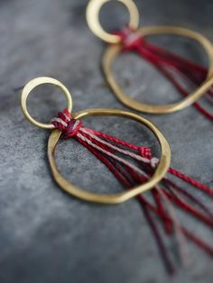 Breezy Point Threaded Hoops | Luxe handmade earrings featuring a double-hoop circular design held together with alpaca thread knotted accents. Post closures.