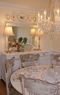 dining room ...white furniture... crystal chandelier... pressed back chairs - WOW!