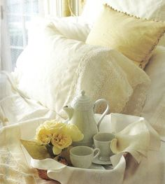 Breakfast in bed with white lace and yellow flowers