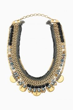 The Colette Statement Necklace is made of vintage gold with semi-precious labradorite beads. Shop beaded statement necklaces at Stella