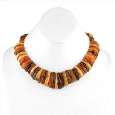 "#Aphrodite Multicolored #AmberNecklace Item No. AM00057A01 $209.29 Wow! This natural amber Aphrodite choker necklace features an assortment of different colors of authentic amber stones from the Baltic Sea in Russia. Each stone holds its own unique-ness and all the larger stones have a flat bottom, for comfort while wearing the necklace. The largest amber stone measures about 1 5/16"" in length, and the smallest measures about 5/16"" long. Hidden barrel clasp. Amber Necklace, Amber Jewelry, Collar Necklace, Beaded Necklace, Necklaces, Baltic Amber, Baltic Sea, Amber Stone, Aphrodite"