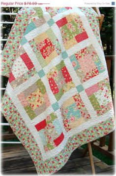 Quilt uses two charm packs.