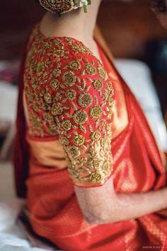 South Indian Bride - Bride in an Orange Kanjivaram Saree with Golden Dabka Embroidery | WedMeGood #wedmegood #indianbride #indianwedding #southindianbride #southindianwedding #bridalblouse #bridaldetails
