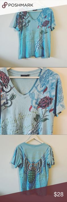 VINTAGE • Baby blue Christian Audigier v-neck tee VINTAGE • Christian Audigier/Ed Hardy skull/tattoo theme Baby blue v-neck t-shirt • In great condition, no holds/tears, no fading, no cracking • Size men's medium. Christian Audigier Shirts Tees - Short Sleeve