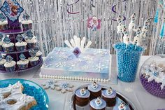 Too-Cool Frozen Treats Ideas from @partycity. Elsa unleashed a blizzard of noms! There's a little something for everyone on this table of snow sweets created by the pros at Wilton. Keep clicking the pics above to see how to create edible snowflakes, sparkling doughnut pops, a tower of cupcakes, an iced Olaf and more!