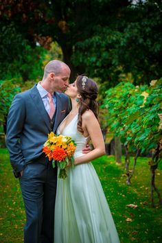 Love these gorgeous orange flowers by Ye Olde Yardley Florists for the perfect fall wedding   Juliana Laury Photography   Philadelphia and Bucks County Wedding Photography