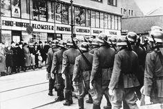Oslo residents line the sidewalks as German reinforcements enter the Norwegian city, May 2, 1940. Unreal.