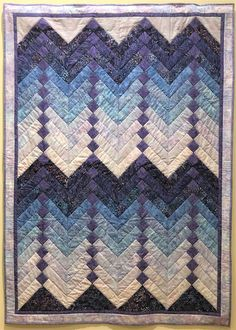 """Lap Quilt """"French Braid by Susan Skornia """"I collected batiks for a French Braid quilt over many years, with this pattern in mind. Each light to dark feather-like section with center squares is called a 'run.' How many 'runs' does this quilt have? Braid Patterns, Quilt Patterns, Braid Quilt, French Braid, Capital City, Squares, Sewing Projects, Feather, Braids"""
