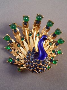 """Boucheron Peacock Brooch popular for decades, from the '60s through the '80s. Not precious stones, but so """"glorious"""" it belongs on this board:)"""