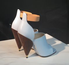 Wood and white leather shoes with heels by Dior