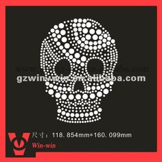 hot fix rhinestone motif in skull design - I like the mixture of stone sizes. Great visual impact, just not the skull for Cheer probably.