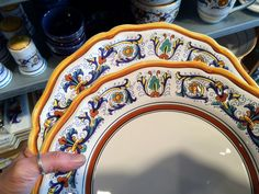 "How to spot fake handmade Italian ceramics: When comparing the two plates, you can see the design is identical - even the ""mistakes"" are uniform from plate to plate. The edges are hand painted to emulate an entirely hand painted piece. Hand Painted Pottery, Pottery Painting, Italian Pottery, Mistakes, Two By Two, Ceramics, Ceramic Plates, Mugs, Tabletop"