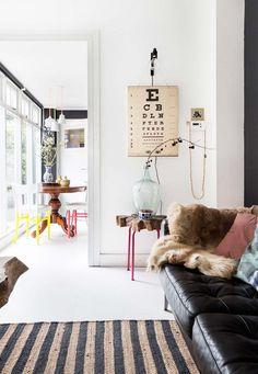 striped area rug with leather sofa. / sfgirlbybay