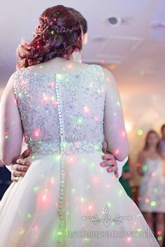 Brides dress detail at Bournemouth Hotel Wedding. Photography by one thousand words wedding photographers