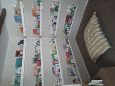 vinyl rain gutters.  $6 for a 10 ft section-quick and cheap.  children love seeing the covers to all their favorites.